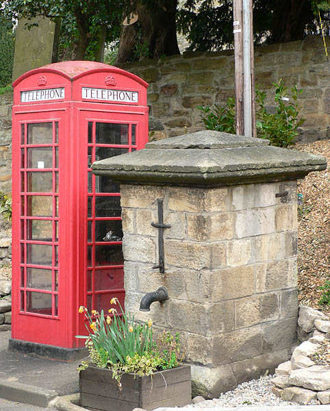 The 18th century village well and the Type K6 telephone box